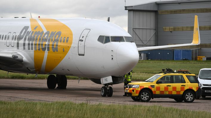 Ein Flugzeug der Primera Air am Flughafen London Stansted (Quelle: PA Wire/Joe Giddens)